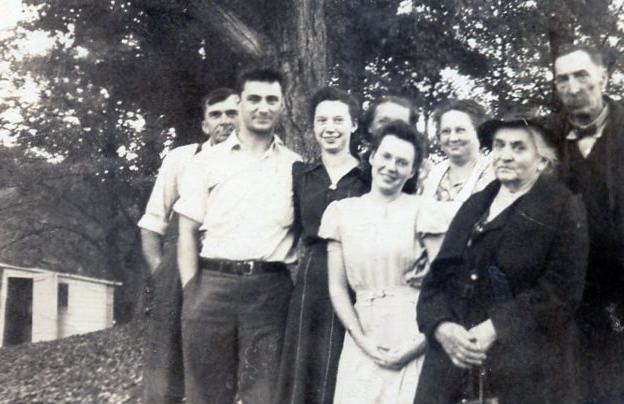 Photo from 1943 of a family gathered on the hill