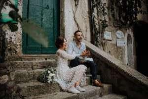 Upstate NY Wedding Filmmaker, Amalfi Coast Elopement couple on steps