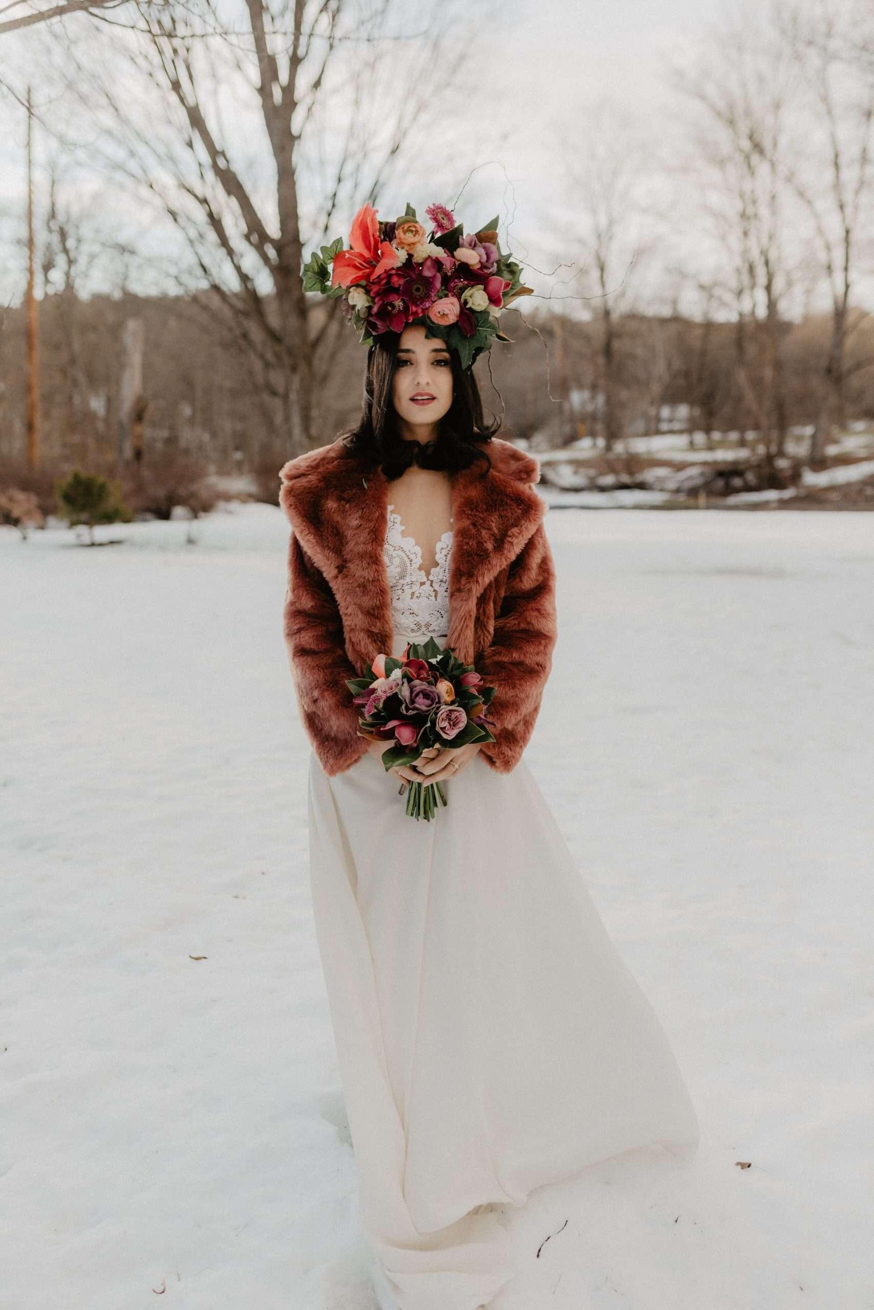winter bride in wedding gown in snow