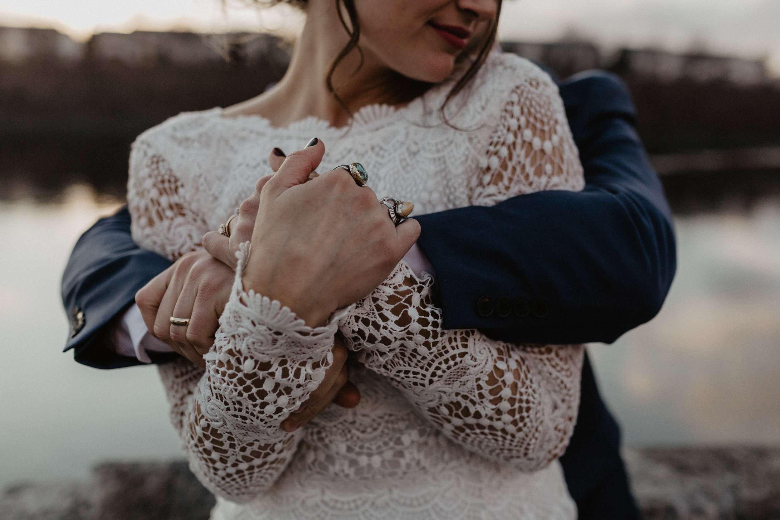 couple hugging, boho wedding gown