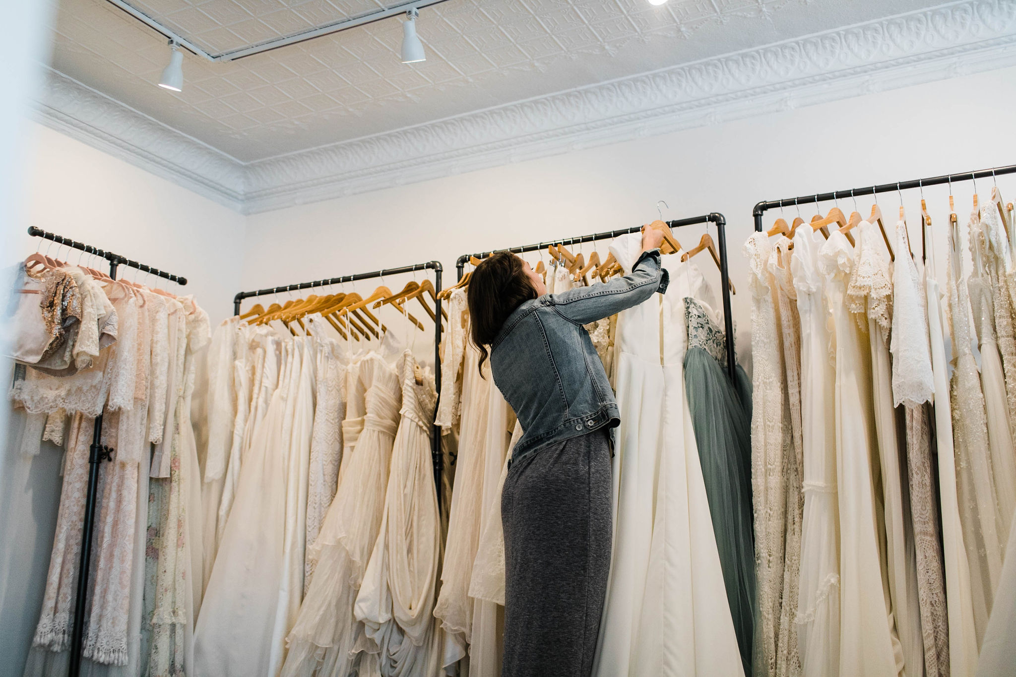 racks of wedding dresses