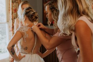 Bride getting her gown on